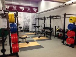 High Performance Centre room with weights, Gee-Gees banner.