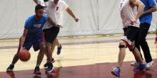 Player in blue dribbling with the ball on the court.