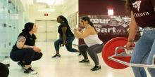 Instructor guiding students through fitness class