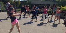 People doing outdoor zumba.