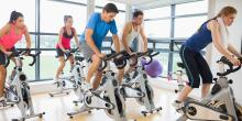 People on a spinning bike during a class.