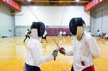 Participants dressed as fencer during camp.