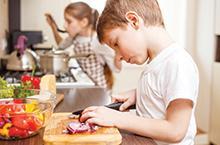 kid in a kitchen